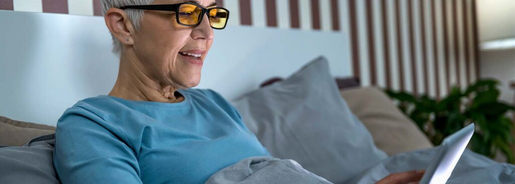 Senior Woman In A Bed With A Tablet